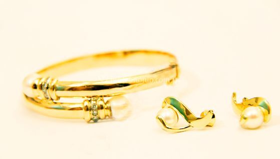 Juegos de joyas doradas