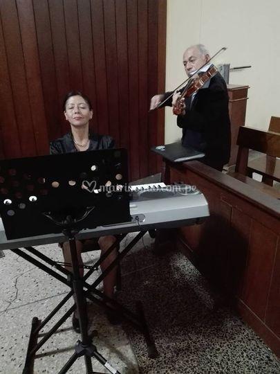Organista y violín