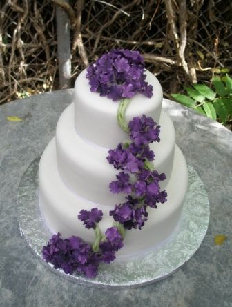 Three Tiered Wedding Cake Decorated With Silk Flowers